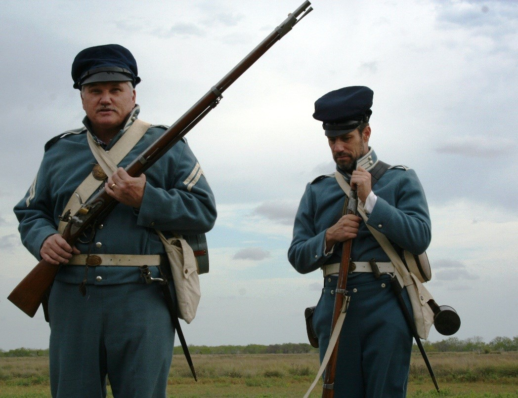 Living historians in Mexican War era U.S. infantry uniforms.