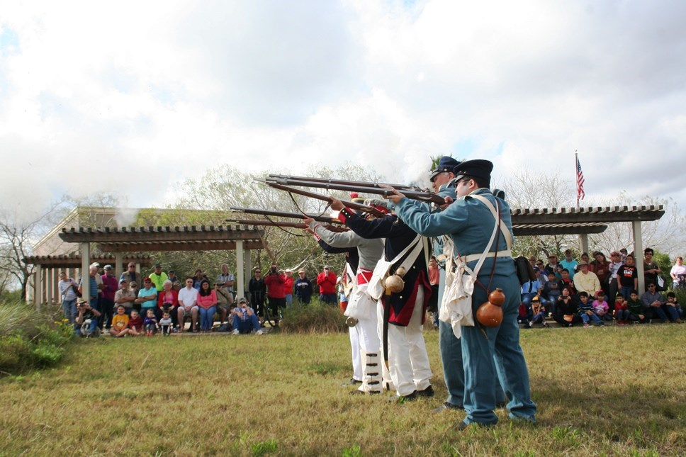 Group of living historian performs a musket demonstration.