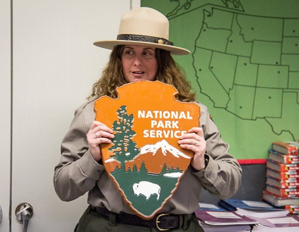 Ranger Ilyse with a NPS arrowhead