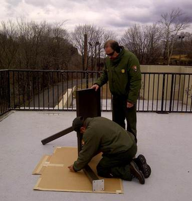 Two rangers assembling wayside exhibit