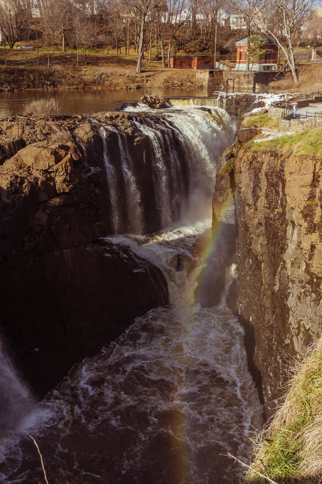 Picture overlooking the Great Falls and a rainbow from the bridge in Mary Ellen Kramer Park