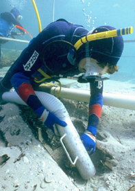 A marine archaeologist excavates the shipwreck site of 1554