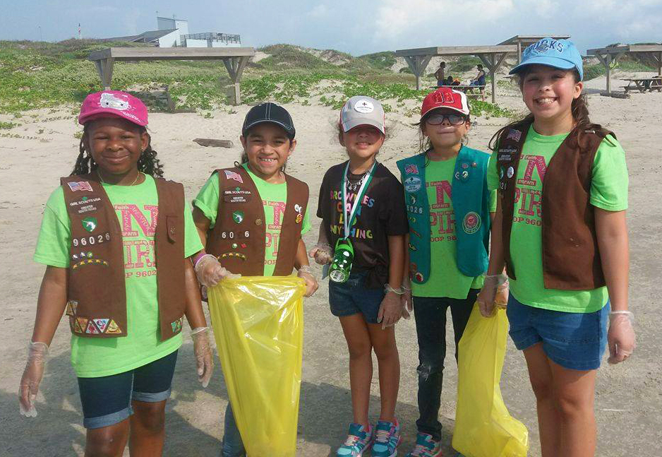 Girl Scouts participate in a beach clean-up at Malaquite Beach.