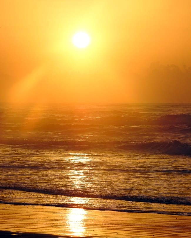 Golden sunrise at Malaquite Beach