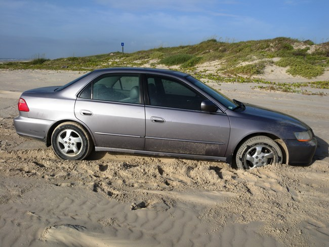 Car stuck in soft sand on South Beach