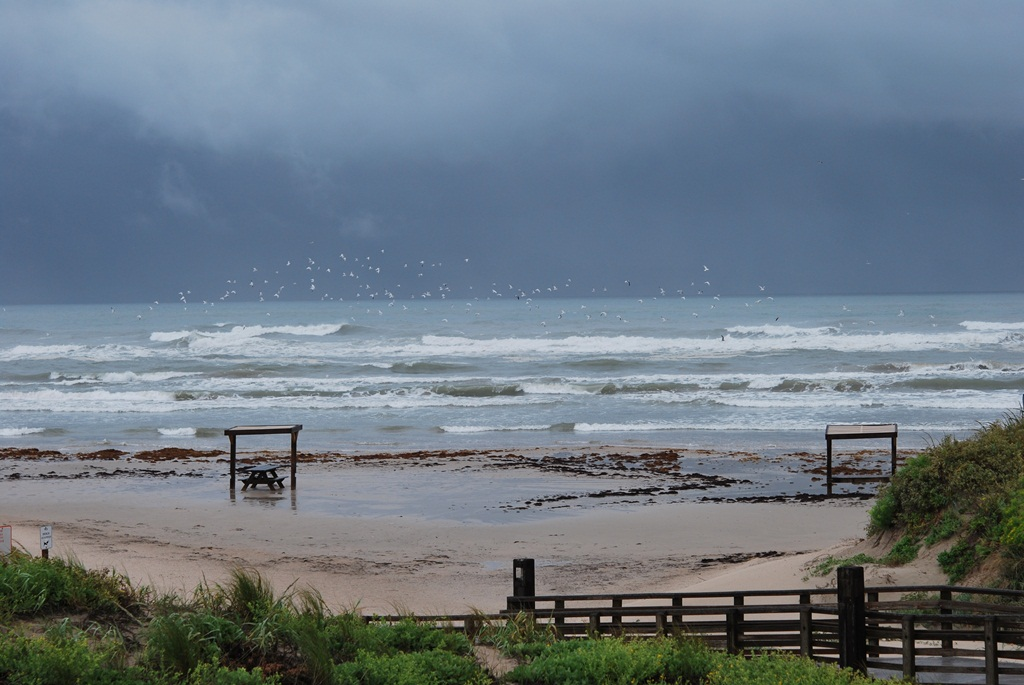Storm clouds and rough surf along Padre Island.