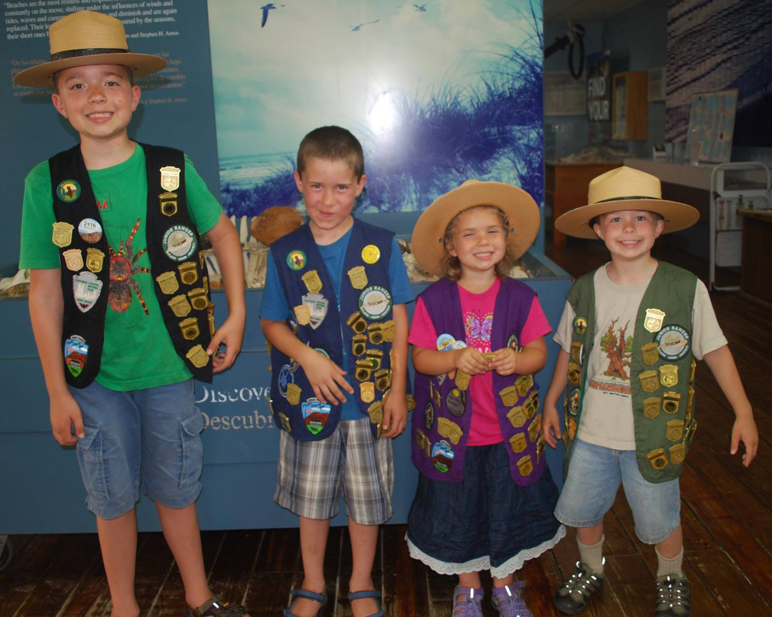 Four recently sworn-in Junior Rangers smile for the camera at Malaquite Visitor Center