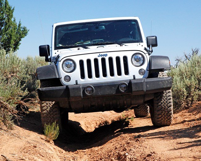 Jeep on deeply rutted road