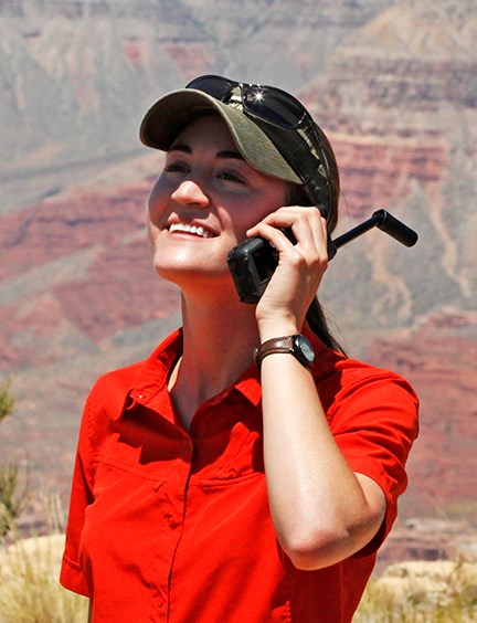 Visitor using a satellite phone