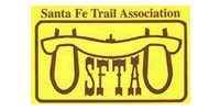 Santa Fe Trail Association logo, yellow with brown lettering, showing a yoke