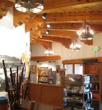 Store interior featuring tinwork chandeliers and hand-carved wood