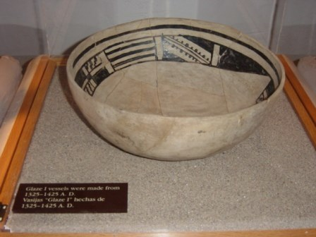 Early ceramic vessel in museum case