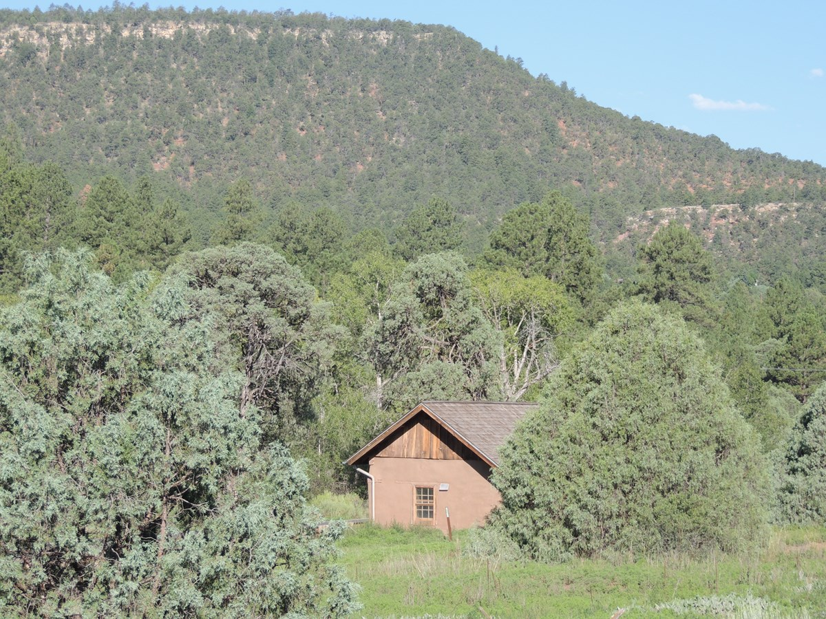 Picture of Pigeon's Ranch with Glorieta Mesa in the background.