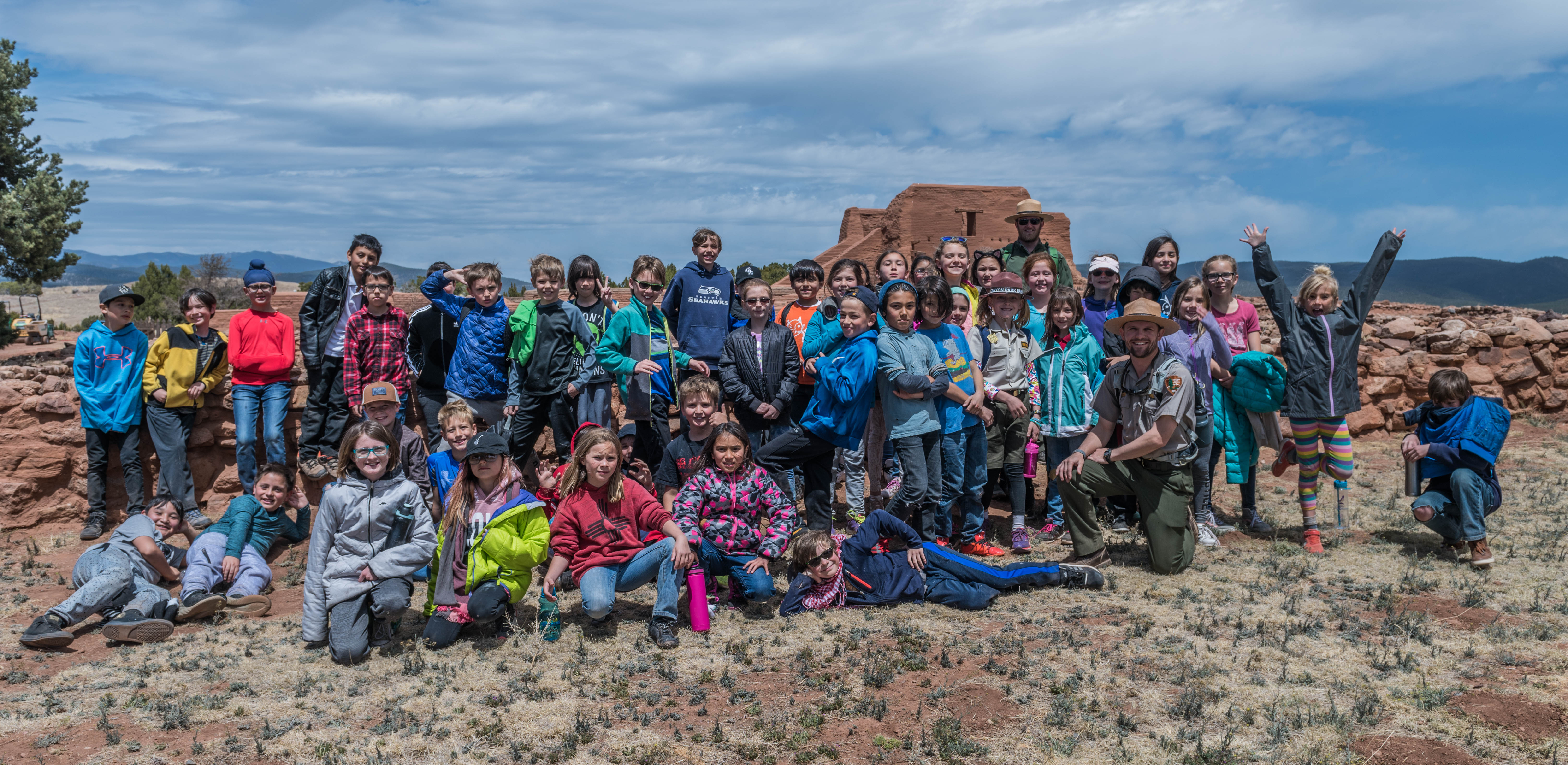 School kids celebrating a field trip to Pecos NHP with a class photo