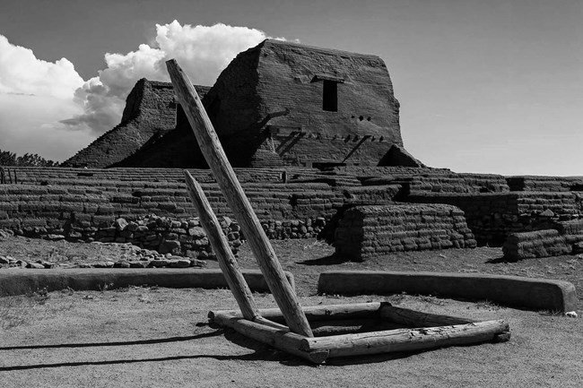 A black and white photo of ancient remains of an ancient building.