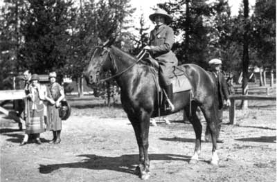 Vintage photo of female ranger on horseback