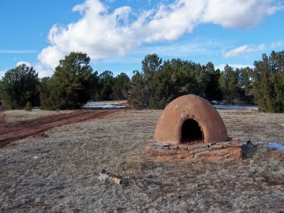 Beehive-shaped oven (horno) on trail behind ranch house