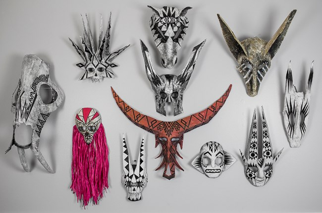 wall of masks by Jym Davis