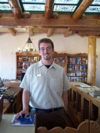 Volunteer Alex Muir working at Painted Desert Inn