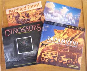 books: Petrified Forest, Painted Desert, Dawn of the Dinosaurs, and Tapamveni