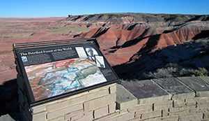 wayside on stone wall overlooking Painted Desert