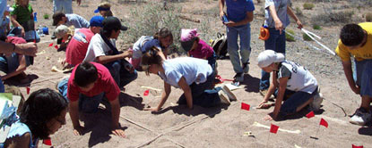 students from Taylor Intermediate working on a mock fossil excavation, NPS Photo