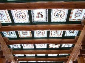 colorful puebloan pottery motifs painted on individual glass panels