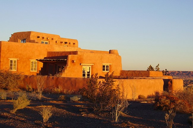 Historic Painted Desert Inn glows in the light of sunrise