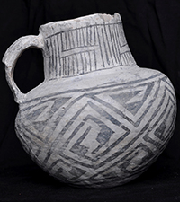 Ceramic jug with black-on-white designs