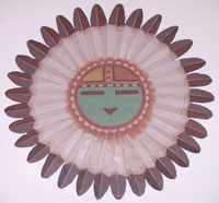 colorful Hopi sun face surrounded by feathers