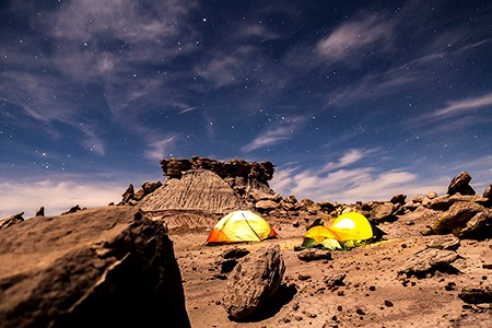 Tents glow under the stars in the Devil's Playground