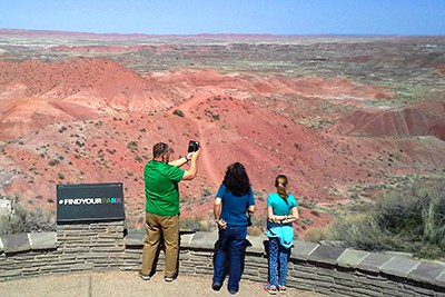 Family enjoying the view of the Painted Desert from Tiponi Point
