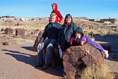 Family enjoying petrified wood along Giant Logs Trail