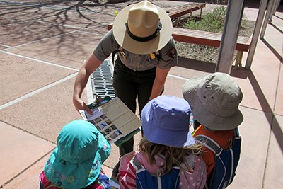 Ranger showing kids some of the park activities