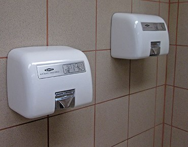 hand dryers attached to wall