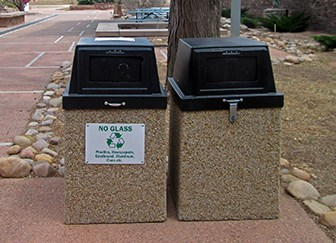 side by side trash and recycling receptacles
