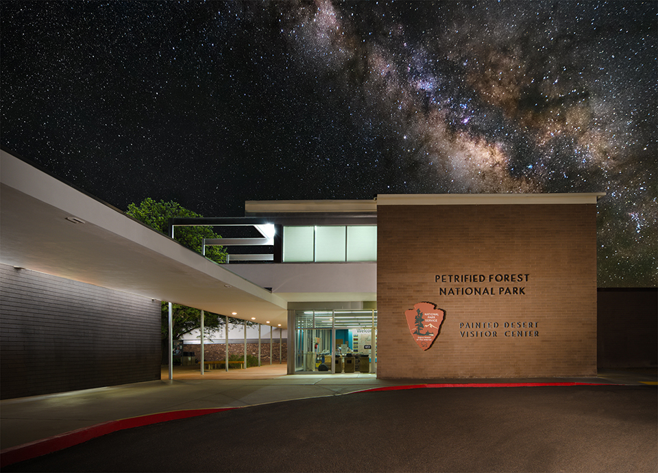 Night at the Painted Desert Community Complex, stars above the softly lit historic buildings.