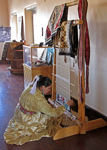 Angeline weaving at Painted Desert Inn
