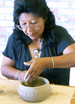 Zuni artist Eileen Yatsattie working on a pot