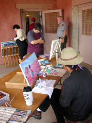 Shonto Begay working on a painting at the Painted Desert Inn