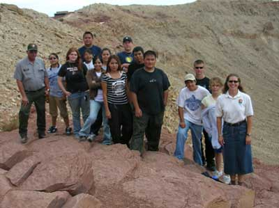 YCC crew and NPS employees standing on the edge of Meteor Crater