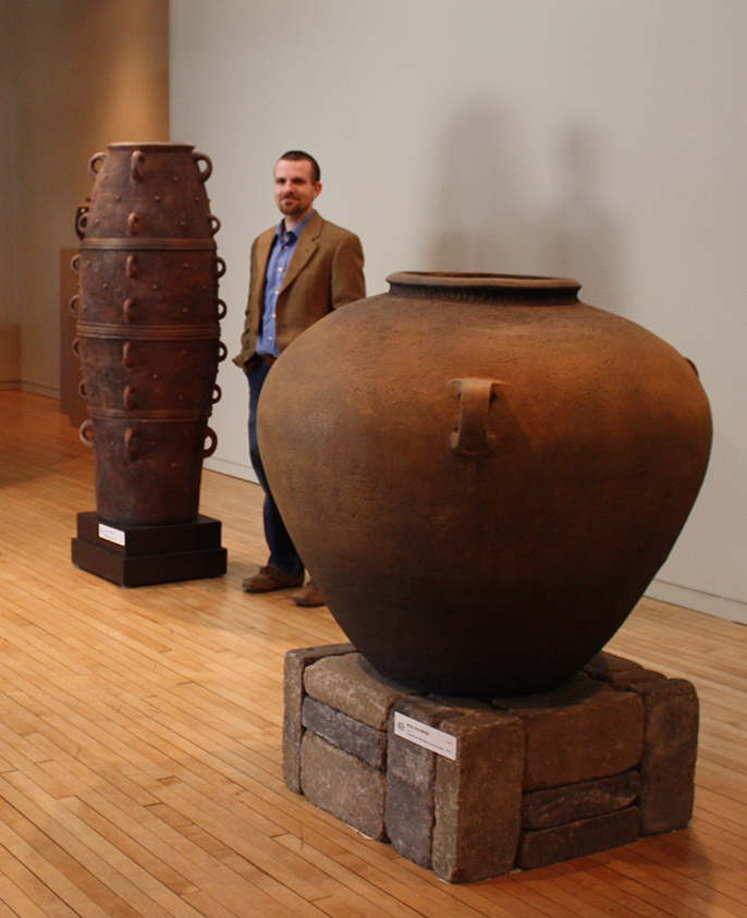 Brad with two of his large  ceramic pots
