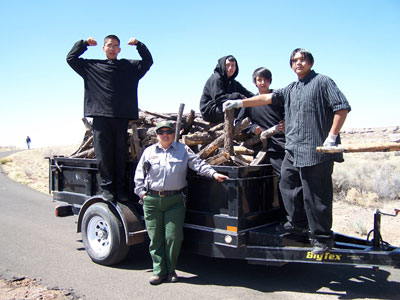 Students and NPS employee show off one of several truckloads of timbers removed from trail.