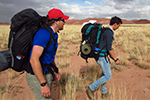 Two backpackers walk in Painted Desert