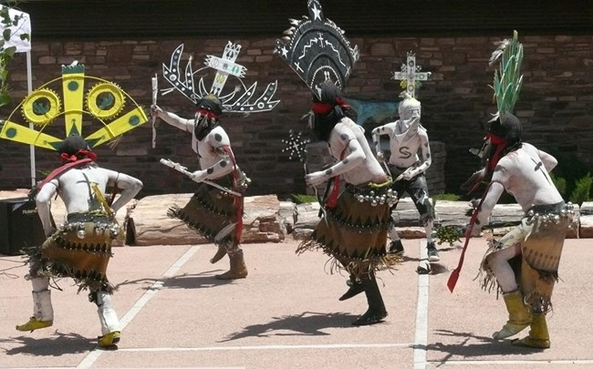 Apache crown dancers in traditional dress