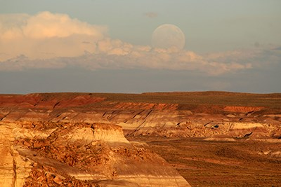Full moon rising over sunset lit Blue Mesa