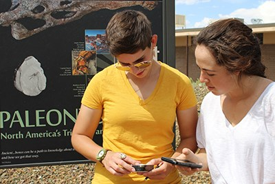 Visitors look at a geocache