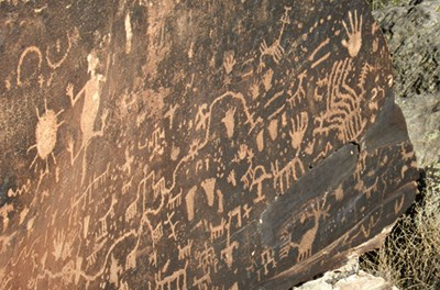 Petroglyphs cover the surface of Newspaper Rock