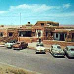 cars with fins parked outside painted desert inn