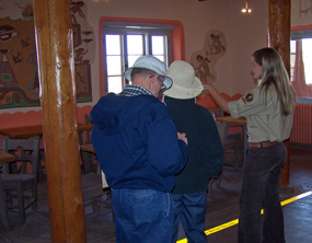 Visitors Learn about the Historic Murals at the Painted Desert Inn